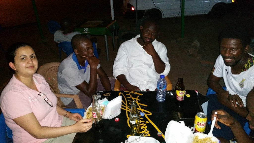 Enjoying indomie after a day of hard work in the field